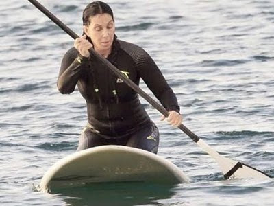 Cher paddle surfing