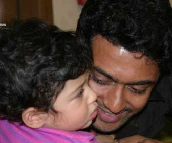 surya playing with his child