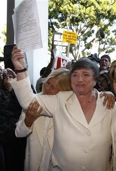 Robin Tyler, right, and Diane Olson at their wedding on June 16, 2008, Los Angeles, California; Robin is holding their marriage certificate, which became legal the day before