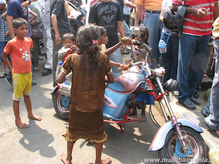 Street children playing on a mini bike