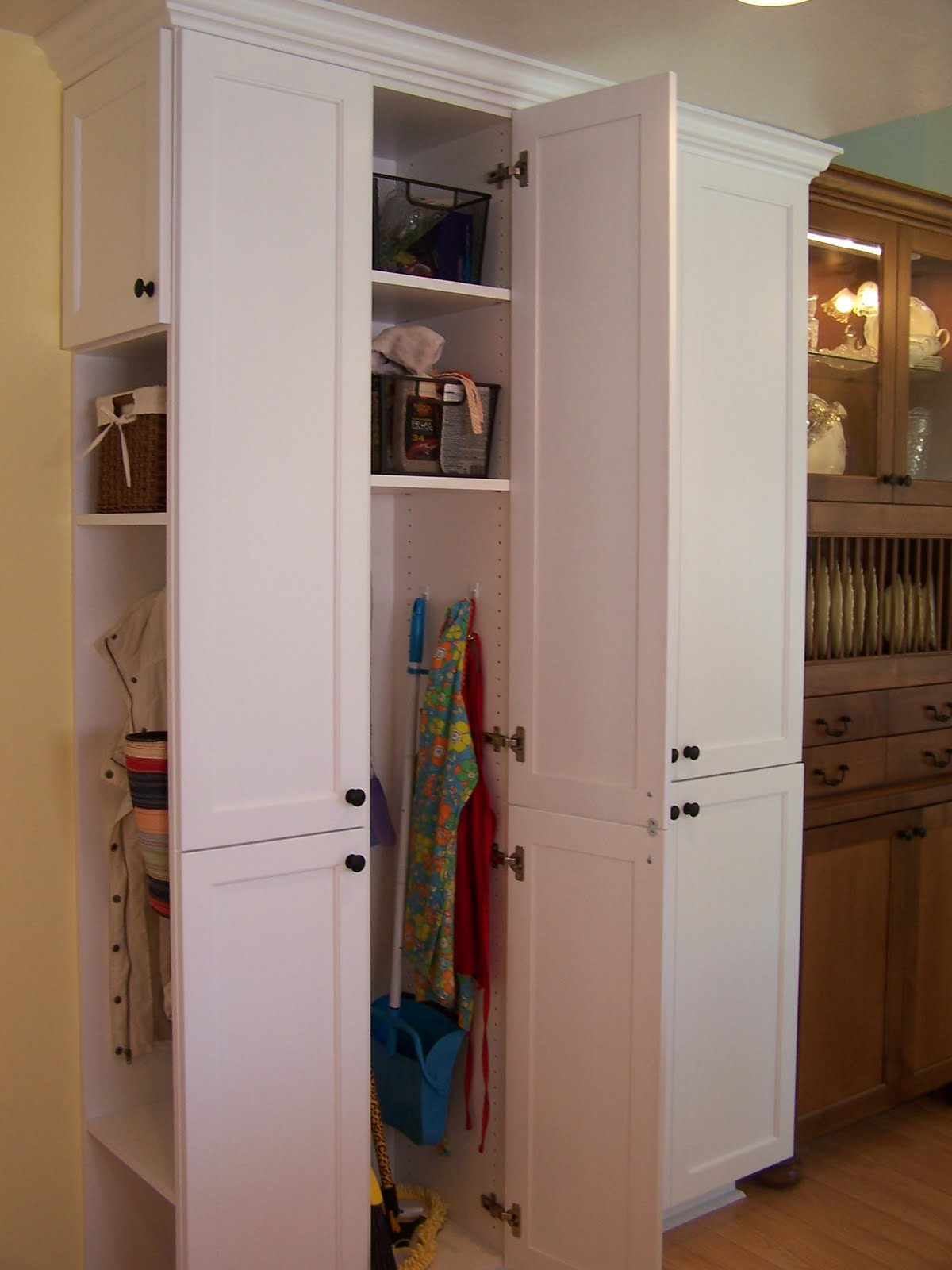 Opinion pantry cabinet with broom closet roselawnlutheran for Kitchen closet