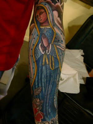 mexican style sleeve tattoo