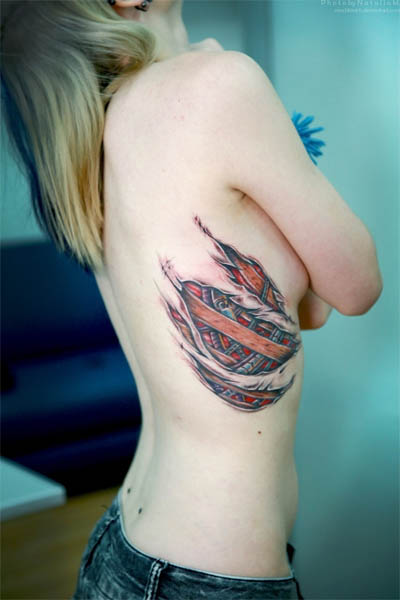 Biomechanical Torn Flesh Ribcage Tattoo | TATTOO DESIGN