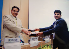 "Suchit Dave being presented with Momentous at the CIB Seminar on ""Judicial Reforms"""