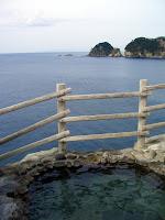 Oceanic view from inside 沢田公園露天風呂 (Sawada-koen open-air hot spring)