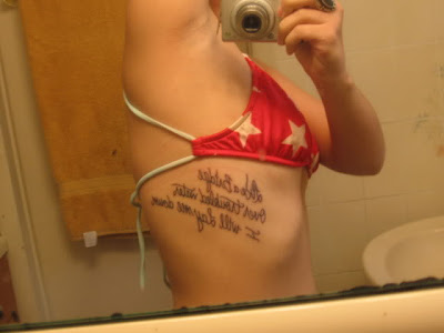 quote tattoos on rib cage for girls. tattoo text rib sexy girls,