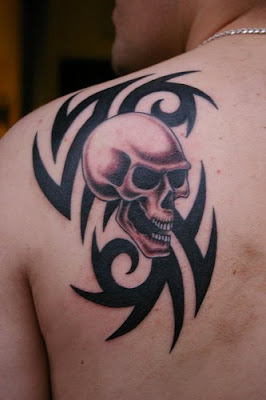 tribal skull tattoo, back upper tattoo ,skull tattoo, back upper tattoo