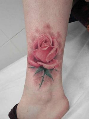 flower tattoos designs. flower tattoo designs on foot.