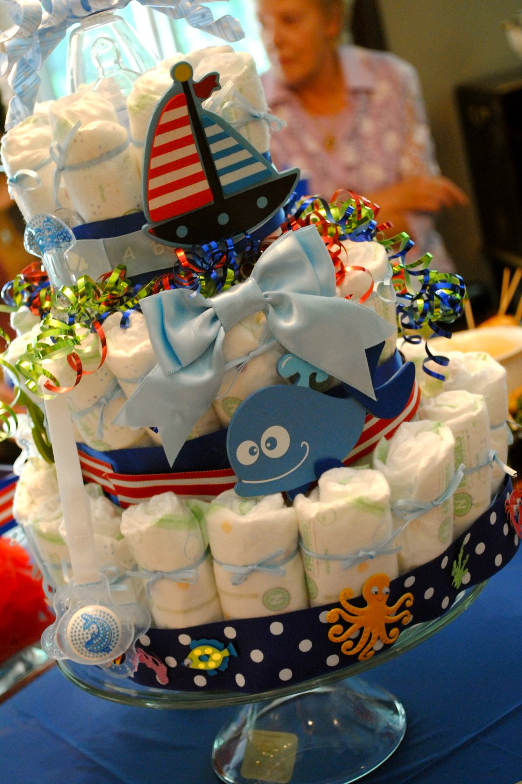 Nautical by nature nautical diaper cakes for baby showers for Baby shower nautical decoration