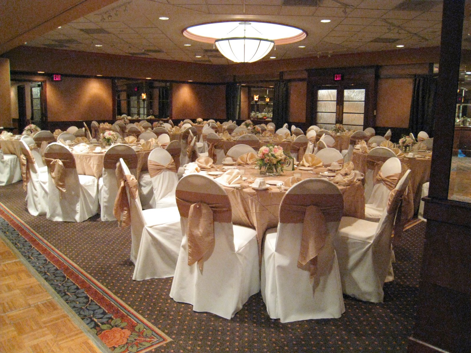 Weber Inn with taupe pintuck table linens and sashes with ivory chair covers