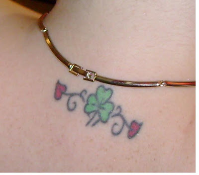 sexy tattoos, shamrock tattoo, stomuch tattoos, tattoos for women,