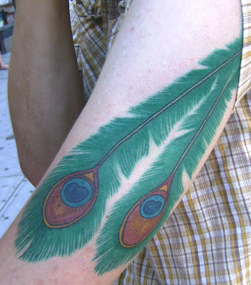 feather tattoo. indian feather tattoos. bright