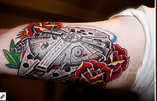 Screenshot of an amazing, vivid Millenium Falcon tattoo. Found on Fuck Yeah,