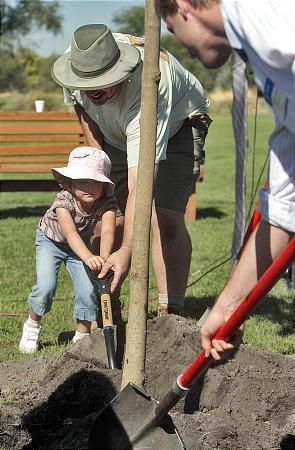 [Trevor+planting+tree.jpg]