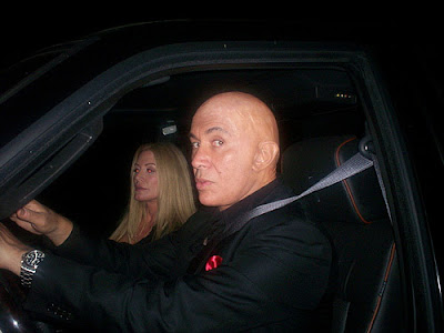 Bald Gene Simmons with wife Shannon Tweed