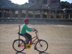 My baby at the temple complex cycling away