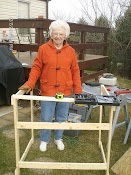 My poor Mom out in the cold helping to build part of stand