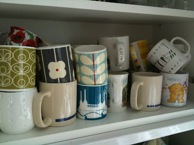 Mug obsession cupboard