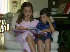 Katelyn reading to Spencer...