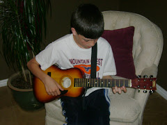 Logan playing his guitar