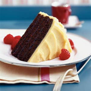 this four layered chocolate raspberry cake features a tangy raspberry ...
