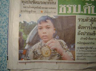 Thai amulet saves boy's life in vehicle accident