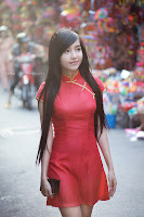 Elly Tran Ha / Elly Kim Hong / Elly Bồ Công Anh in her Country's National Costume