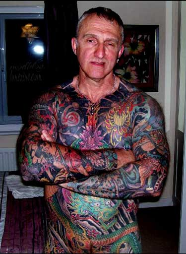 man who is having his entire body tattooed to look like