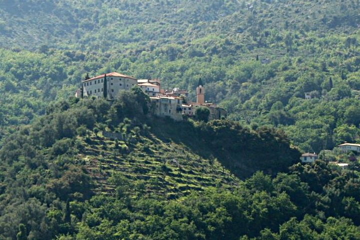 village perched on wooded hill