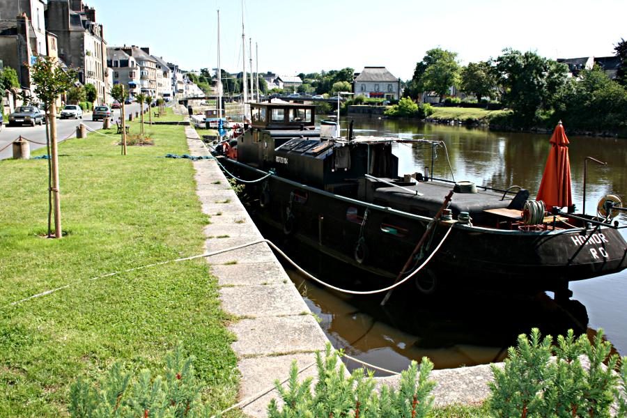 black barge moored on canal