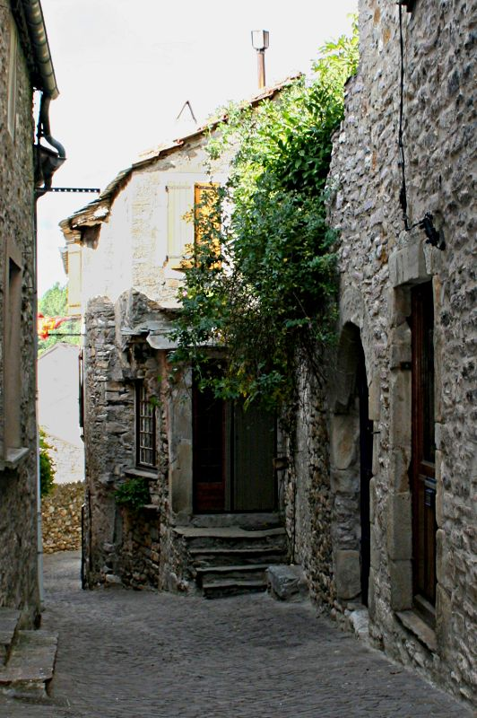 alley between stone houses