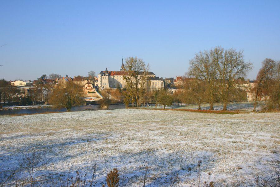 monastery seen from across snowy fields
