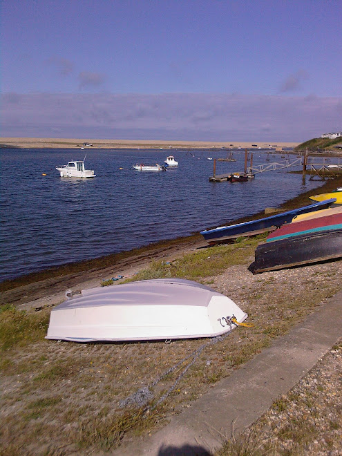 UPTURNED WHITE BOAT AT FERRYBRIDGE