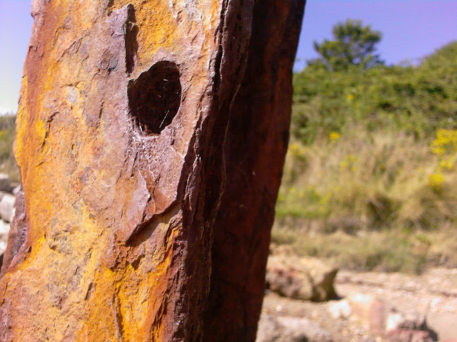 RUSTY METAL WITH HOLE