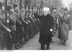 Arab Leader Al-Husseini greeting Nazi SS troops