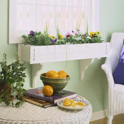 idea para decorar una ventana con una jardinera