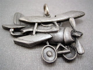 old airplane pendant