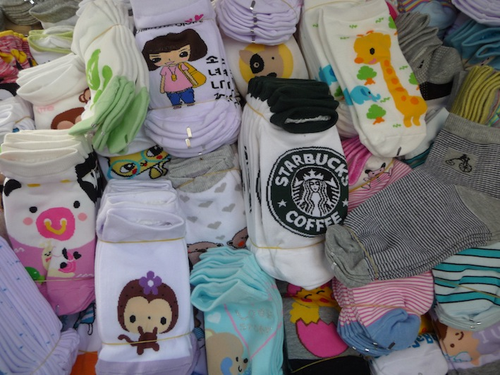 Fancy a pair of Starbucks socks? I think not. But I'll take a pair with the  purple-flower monkey. Cuteness is definitely a prominent aspect of Korean  ... - FoodQuest.SEOUL: Socks!