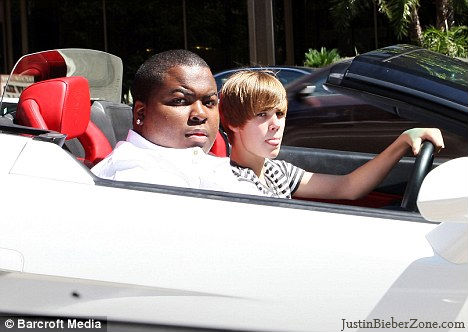 justin bieber driving his car. Justin was Driving his White