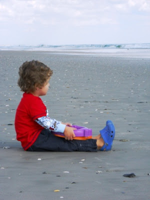 play at the beach in fall for kids