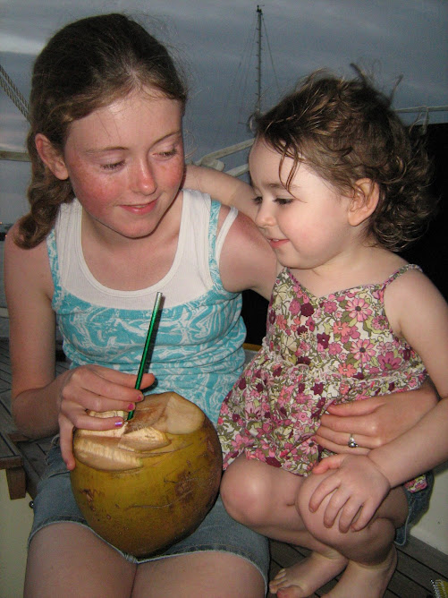Rheannon and Jillian sharing a 'drinking' coconut.
