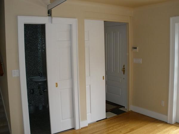 Sliding door doubles to close bathroom or bedroom.