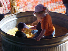 Playing in the corn bin