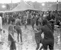 1973 Watkins Glen crowd dancing in mud and rain