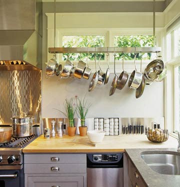 storing pots and pans with a hanging pot rack in an area where much of the prep work of cooking occurs proves to be very convenient - Kitchen Pot Rack Ideas