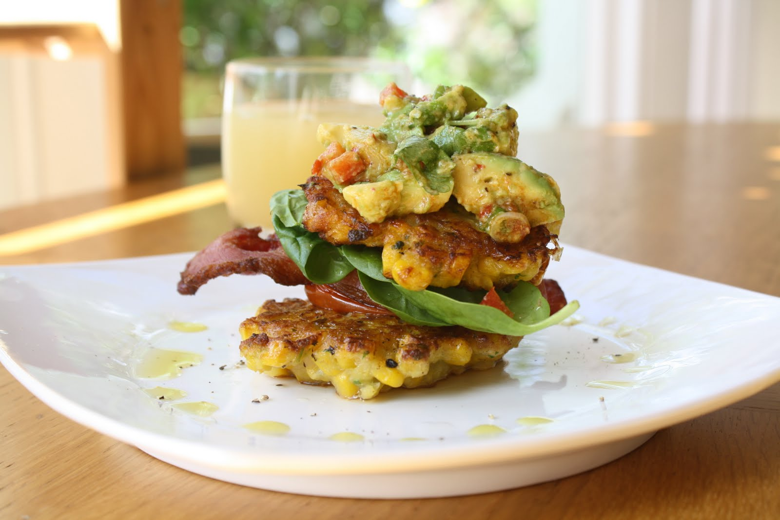 ... : CORN FRITTERS WITH CRISPY BACON, ROASTED TOMATOES & AVOCADO SALSA