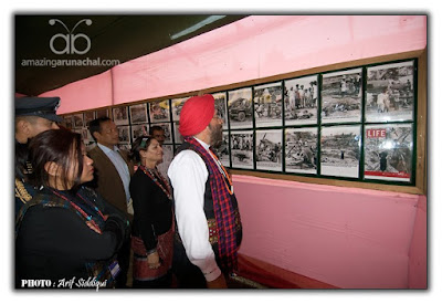 Retd. General of Army admiring the rare collection of WWII photographs