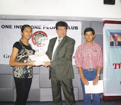 Mukesh Sharma  felicitates the achievers..