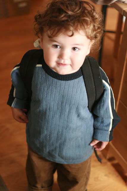 boy at first day of daycare with backpack