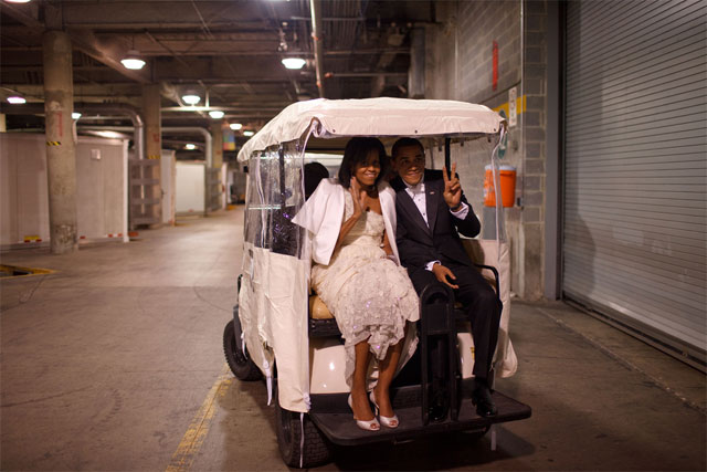 Obama and Michelle in a Golf Kart
